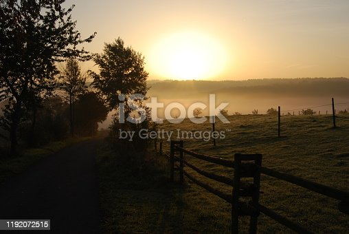 Sunrise on a foggy morning in country Germany
