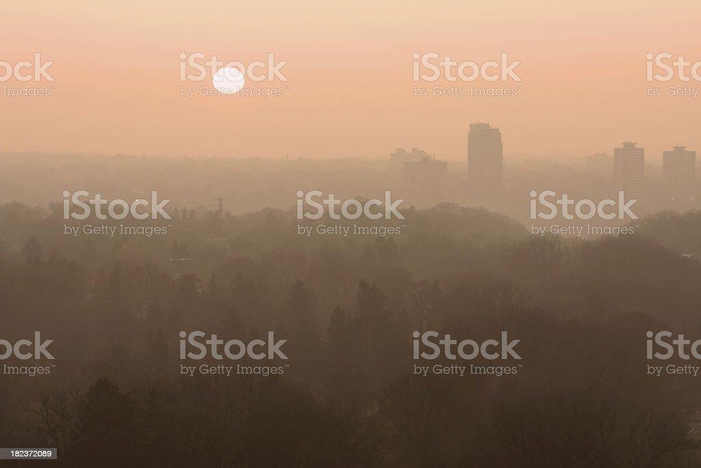 Sunrise Over Foggy City royalty-free stock photo
