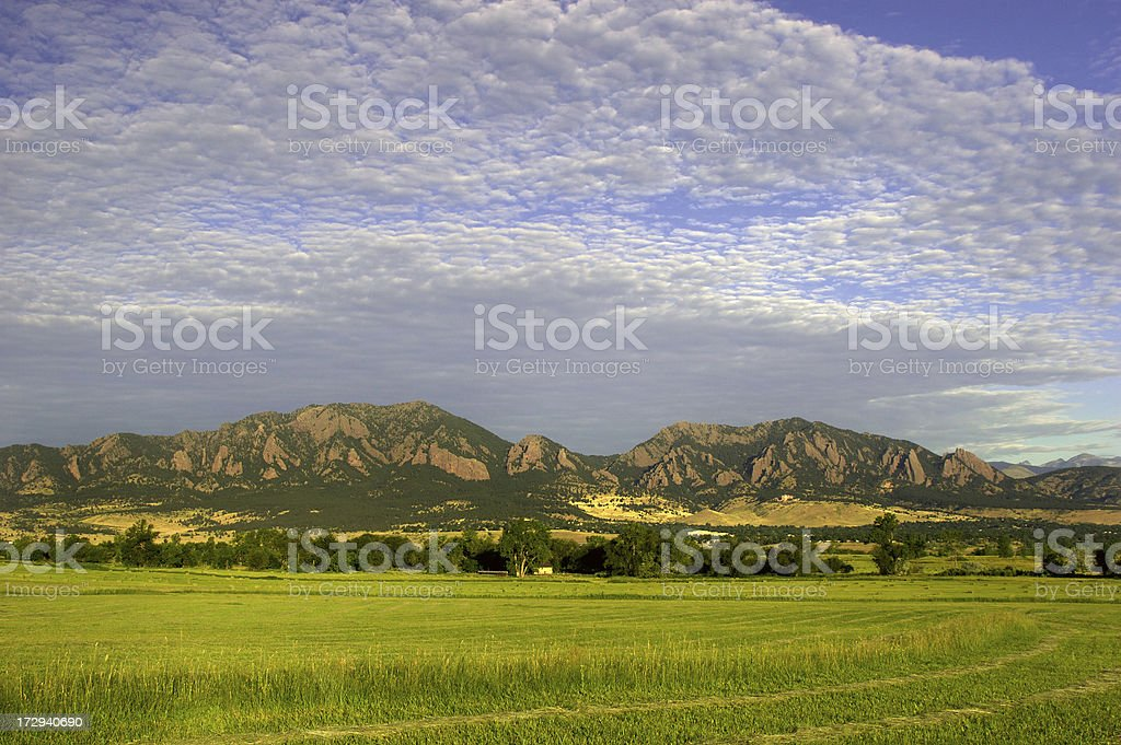 Sunrise over hayfield royalty-free stock photo