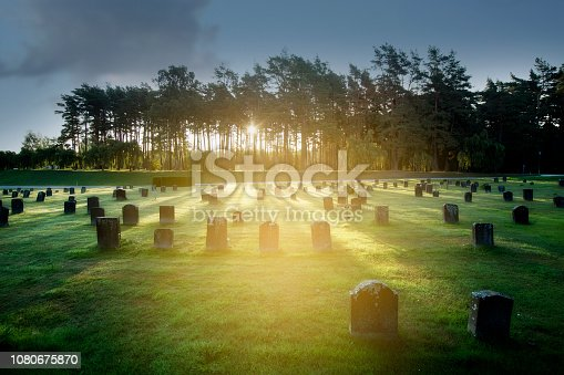 Sunrise over Unesco heritage Woodland cemerery in Sweden.
