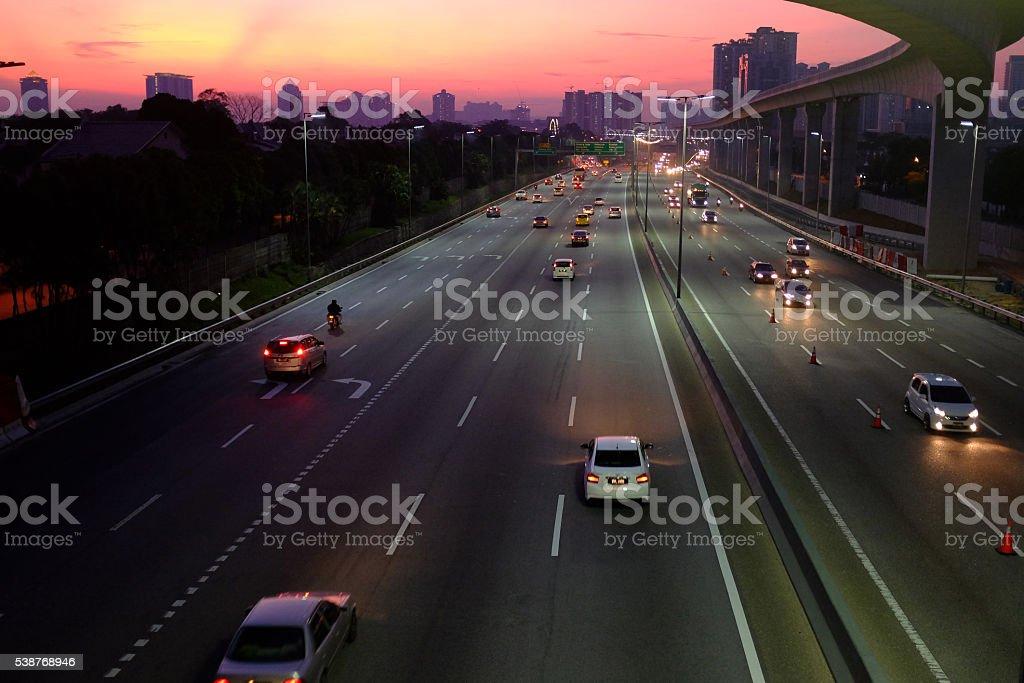 sunrise over highway stock photo
