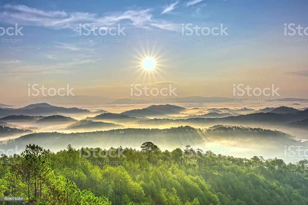 Sunrise over hill stock photo
