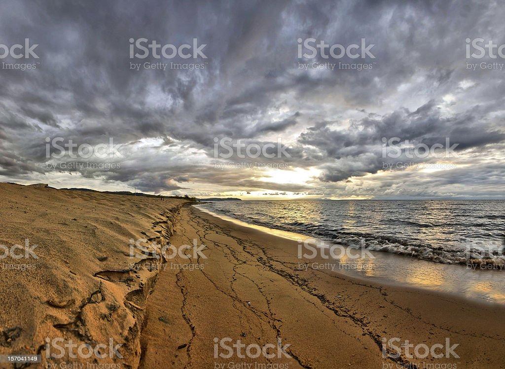 Sunrise over Lake Malawi on beach stock photo
