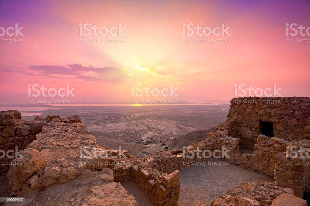 Sunrise over Masada fortress in Judaean Desert stock photo