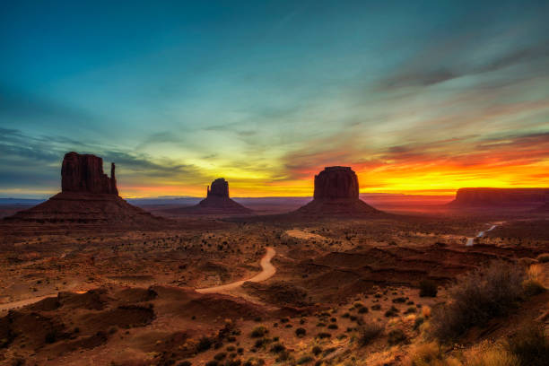 sunrise over monument valley, arizona, usa - native american reservation stock photos and pictures