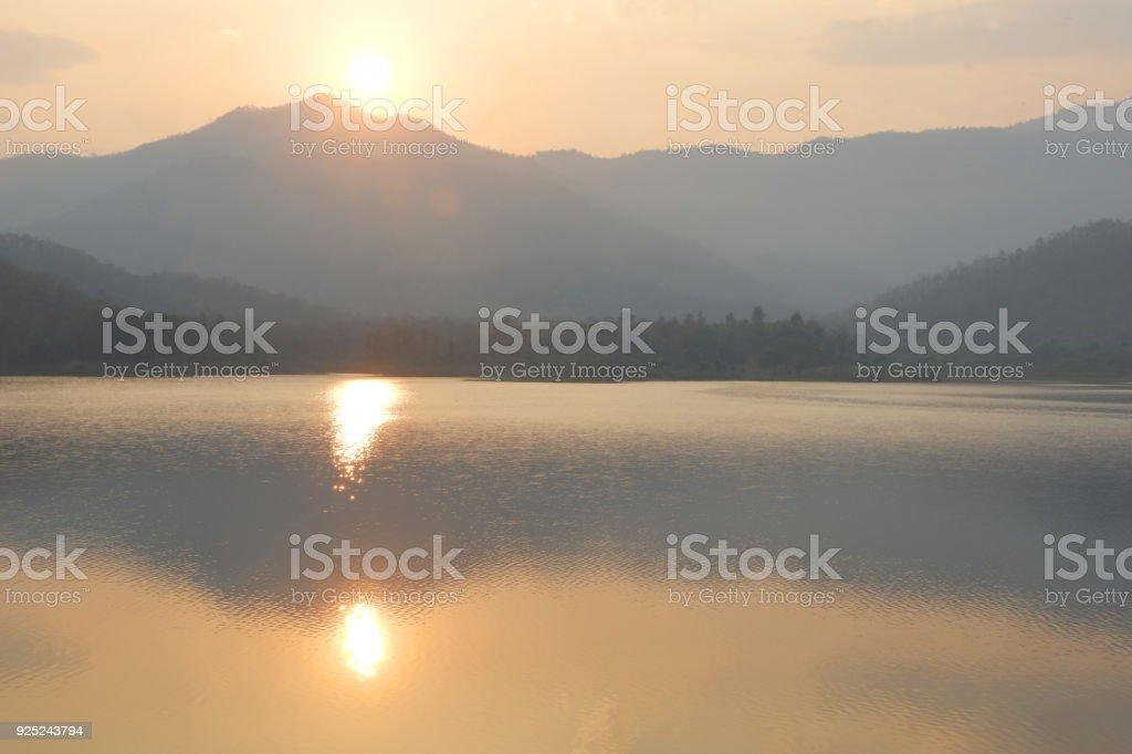 Sunrise over mountain on the lake. stock photo