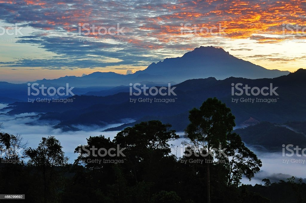 Sunrise over Mt. Kinabalu silhouette, Kota Kinabalu Sabah Borneo Malaysia. stock photo