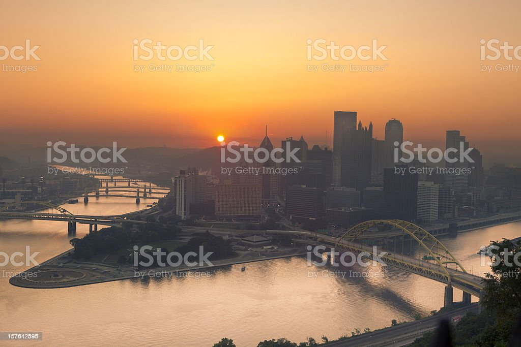 Sunrise over Pittsburgh Illuminates Sky in Orange From Summer Haze stock photo