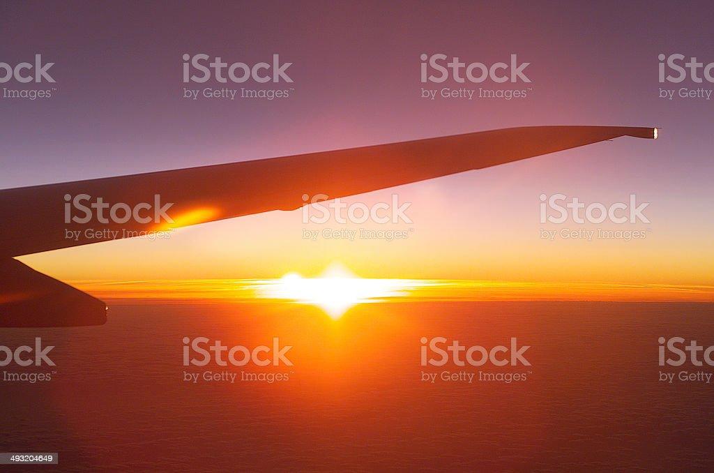Sunrise over plane wing stock photo