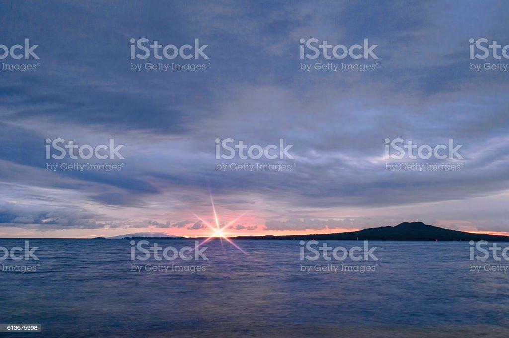 Sunrise over Rangitoto with flare stock photo