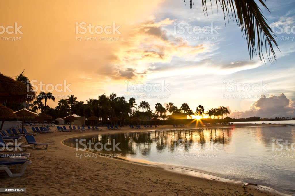Sunrise over Renaissance Beach in Oranjestad Aruba stock photo