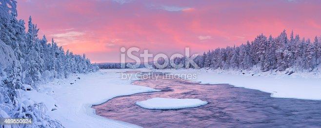 istock Sunrise over river rapids in a winter landscape, Finnish Lapland 469550624