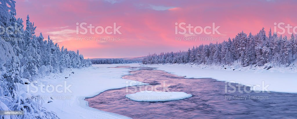 Sunrise over river rapids in a winter landscape, Finnish Lapland stock photo