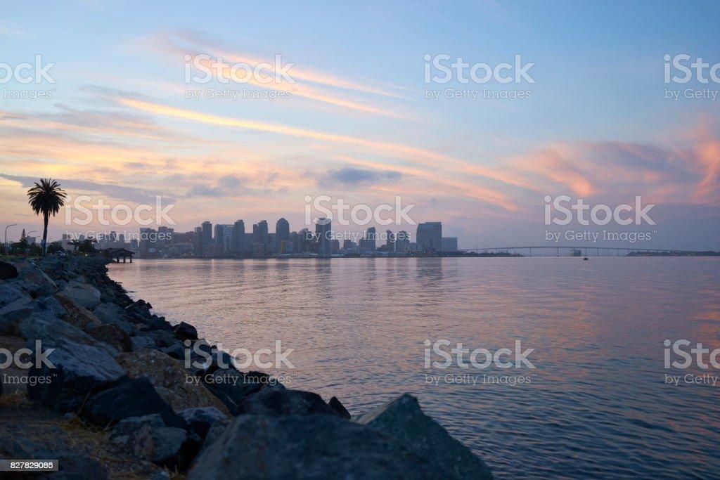 sunrise over San Diego and Coronado Bay as a tanker passes under the Coronado Bridge stock photo