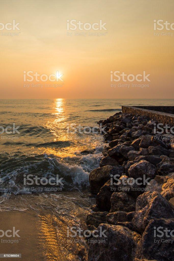 Sunrise over sea and stone coast. stock photo