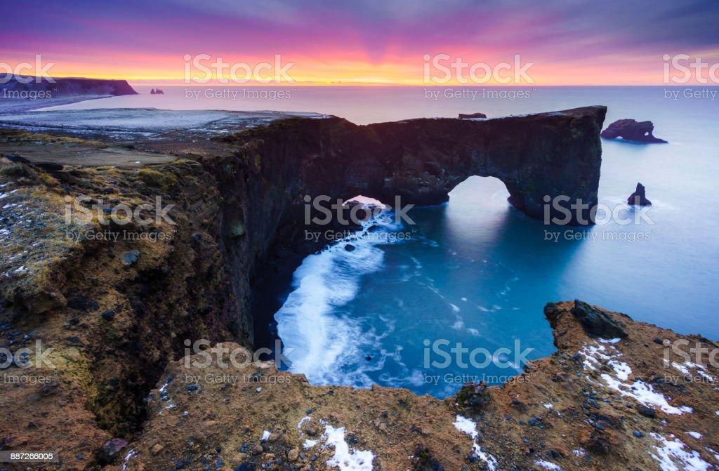 Sunrise over Sea arch at Dyrholaey peninsula , South of Iceland stock photo