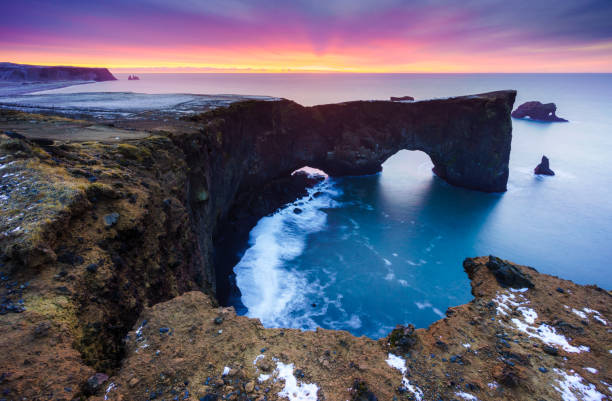 Sunrise over Sea arch at Dyrholaey peninsula , South of Iceland