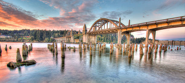 Sunrise over Siuslaw River Florence Oregon Drawbridge Pacific Coast HDR stock photo