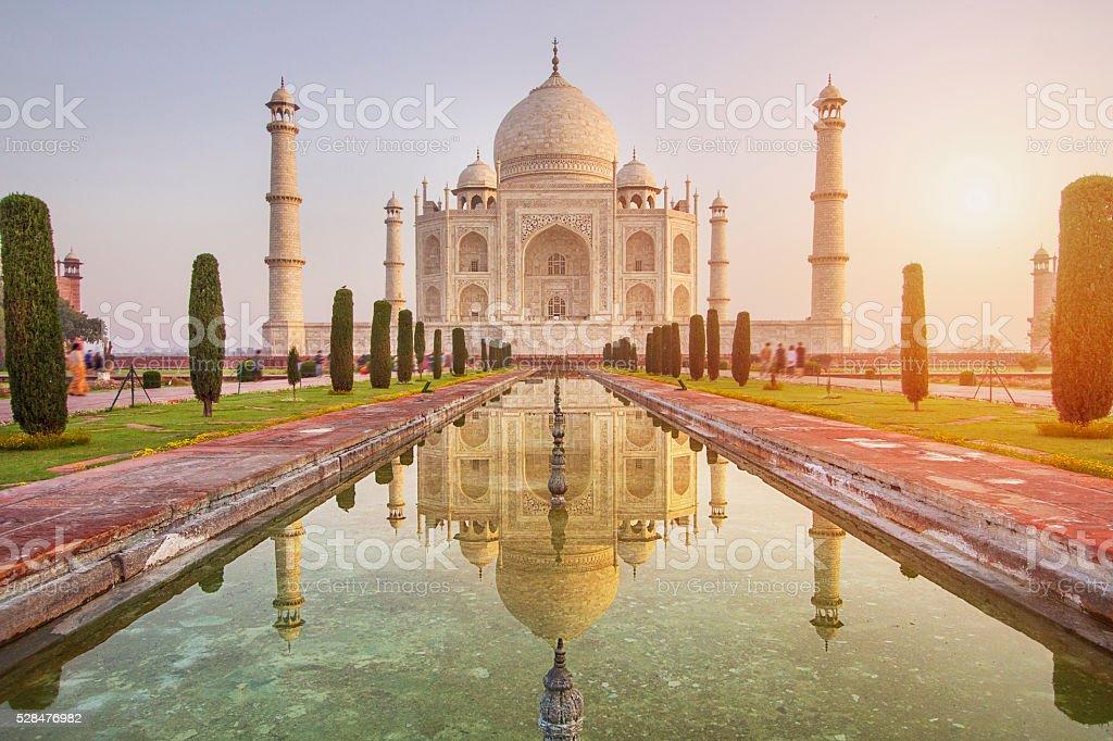 Sunrise over Taj Mahal Early sun rising over the Taj Mahal, India Architectural Dome Stock Photo
