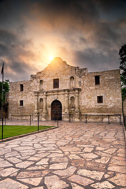 sunrise over the alamo - the alamo stock photos and pictures