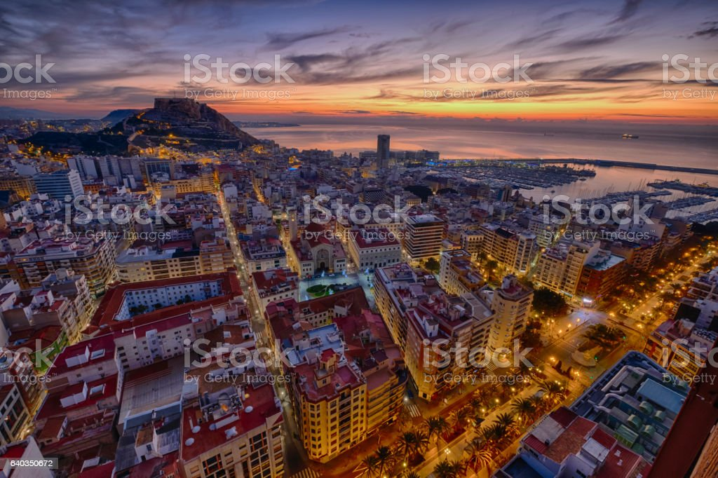 sunrise over the ancient city of Alicante in Spain stock photo