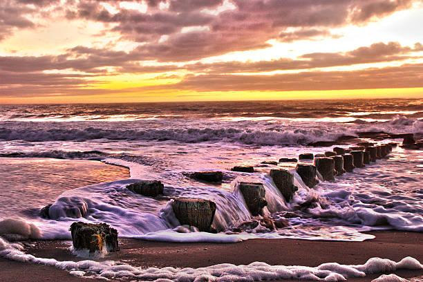 HDR Sunrise over the Atlantic Beach Landscape Sea foam  Pier stock photo