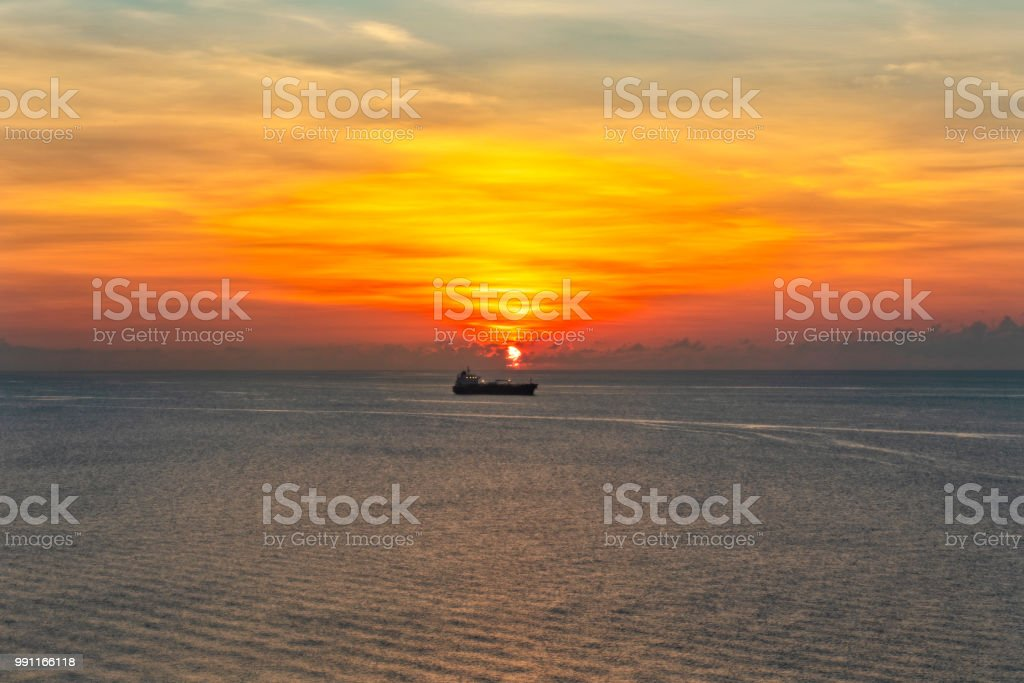 Sunrise over the Atlantic Ocean with ship in background stock photo