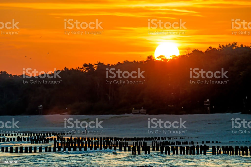 Sunrise over the Baltic Sea with groins stock photo
