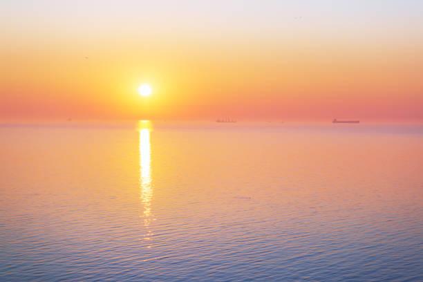 Sunrise over the calm sea, minimalistic landscape