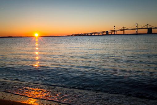The sunrises over the Chesapeake Bay Bridge.
