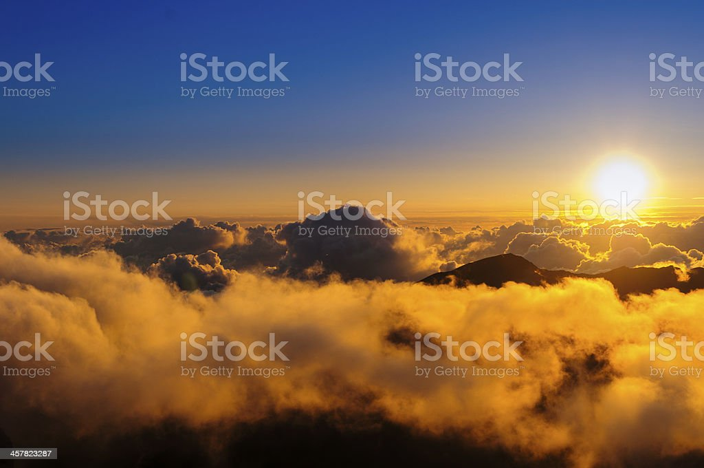 Sunrise over the clouds - Haleakala Crater, Maui, HA, USA stock photo