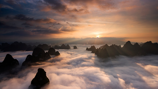 Sunrise over the clouds with karst formation mountains in Guilin, China