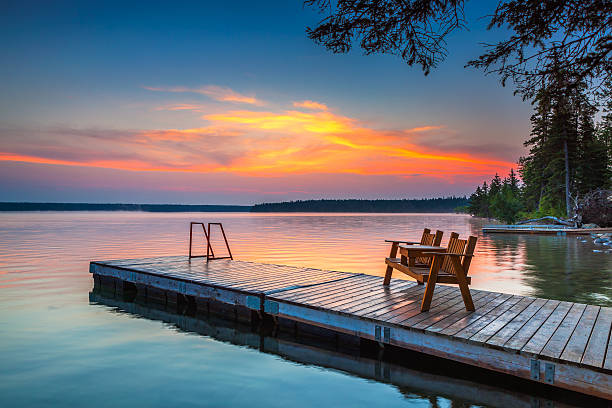 Sunrise over the dock in Clear Lake, Manitoba stock photo