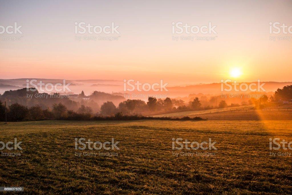 Sunrise over the hills stock photo
