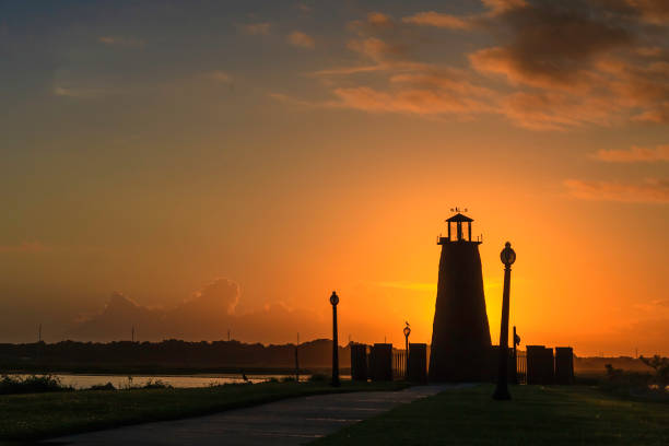 sunrise over the lighthouse on lake toho - kissimmee stock photos and pictures