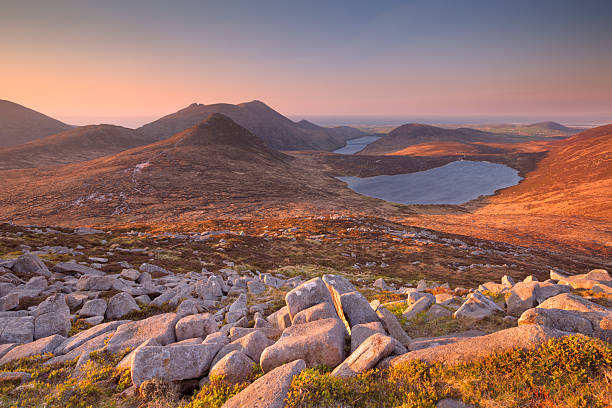 Sunrise over the Mourne Mountains and lakes in Northern Ireland stock photo