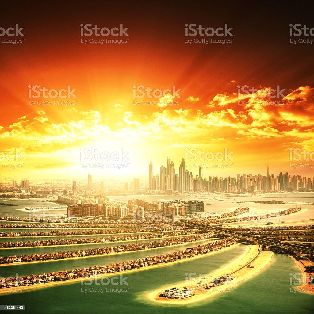 sunrise over the palm jumeirah in Dubai with skyline stock photo