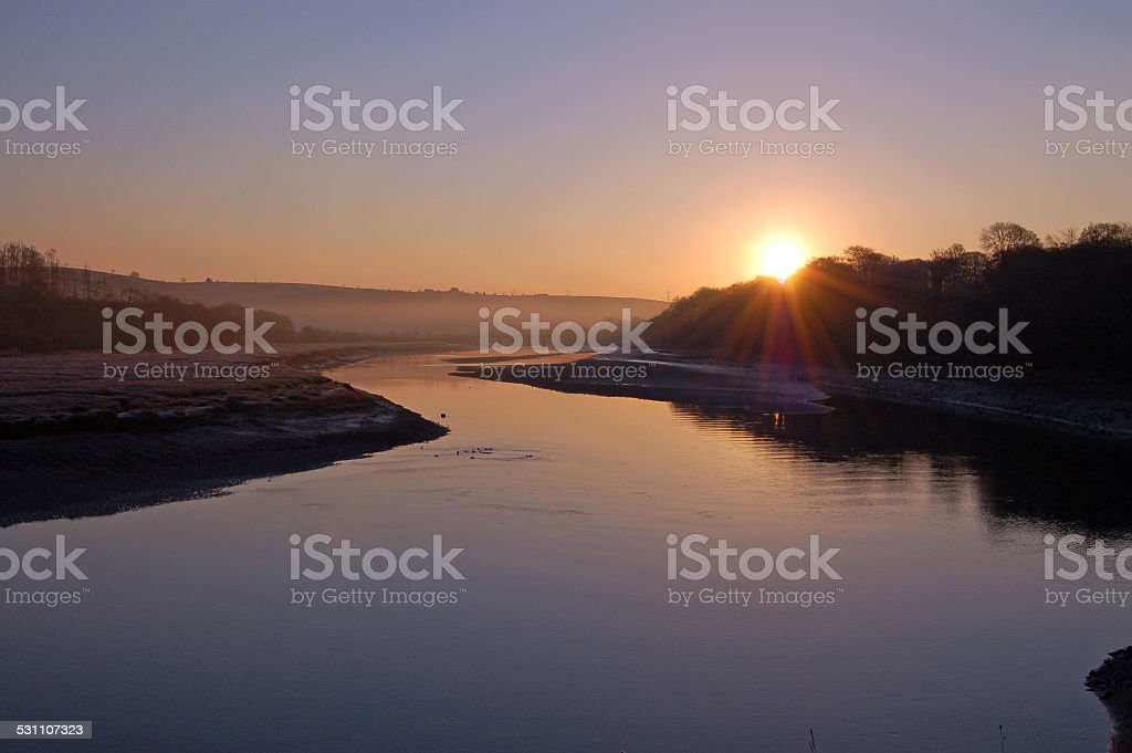 Sunrise over the river stock photo