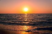 Sunrise over the sea. Beautiful seascape in morning sunlight