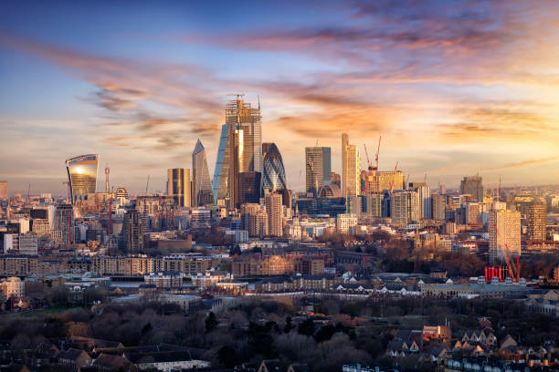 Sunrise over the urban skyline of the City of London, UK Sunrise over the urban skyline of the City of London, UK, financial district and hub of banking institutions london england stock pictures, royalty-free photos & images