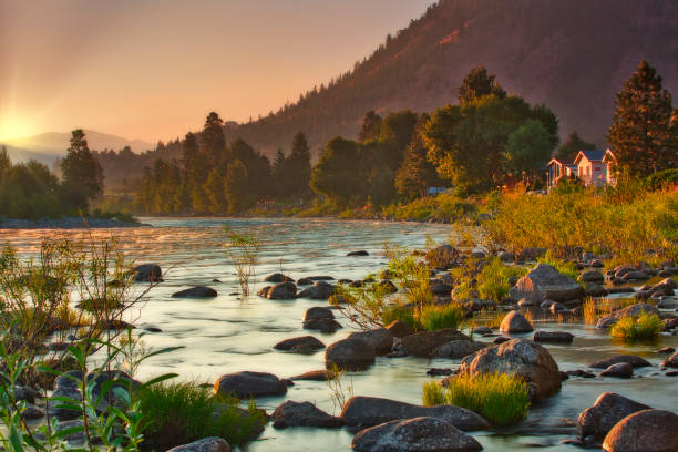 Sunrise over the Wenatchee River during summer fires in North Central Washington stock photo