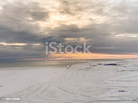 Sunrise over frozen tundra along Hudson Bay in Churchill, Manitoba, Canada.