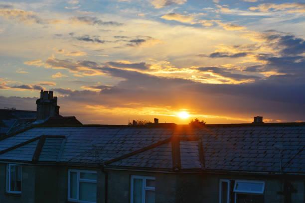 Sunrise Over Urban Rooftops stock photo