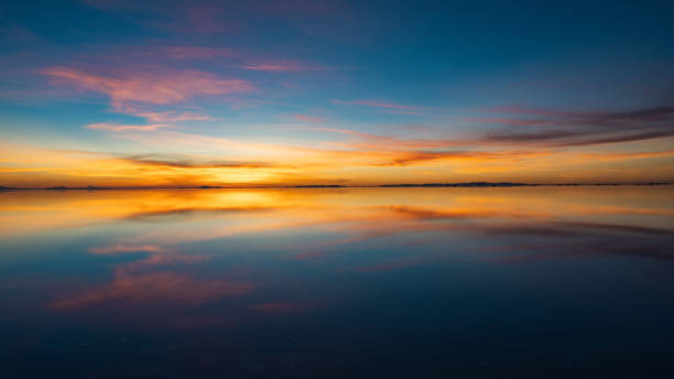 Sunrise Over Uyuni Salt Flats in Bolivia, South America Sunrise over Uyuni Salt Flats in Bolivia, South America. reflection lake stock pictures, royalty-free photos & images