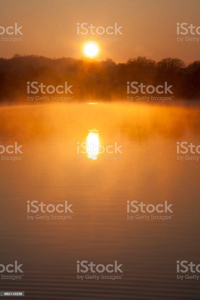 sunrise over water stock photo