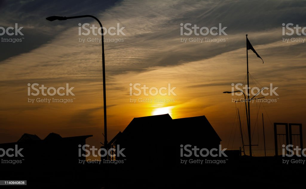 Sunrise over wooden sheds stock photo