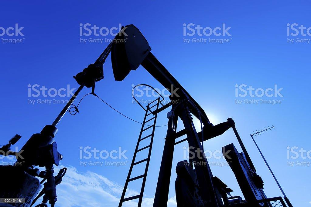 Sunrise Pumpjack stock photo