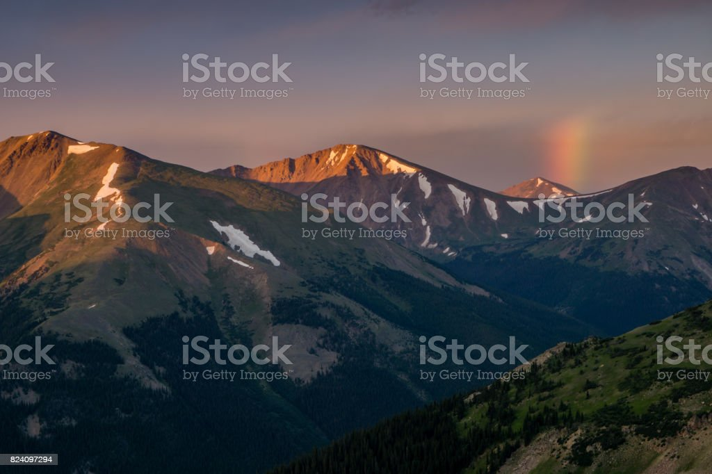 Sunrise Rainbow in the Colorado Mountains stock photo