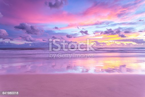 istock Sunrise reflections over the beach 641980018