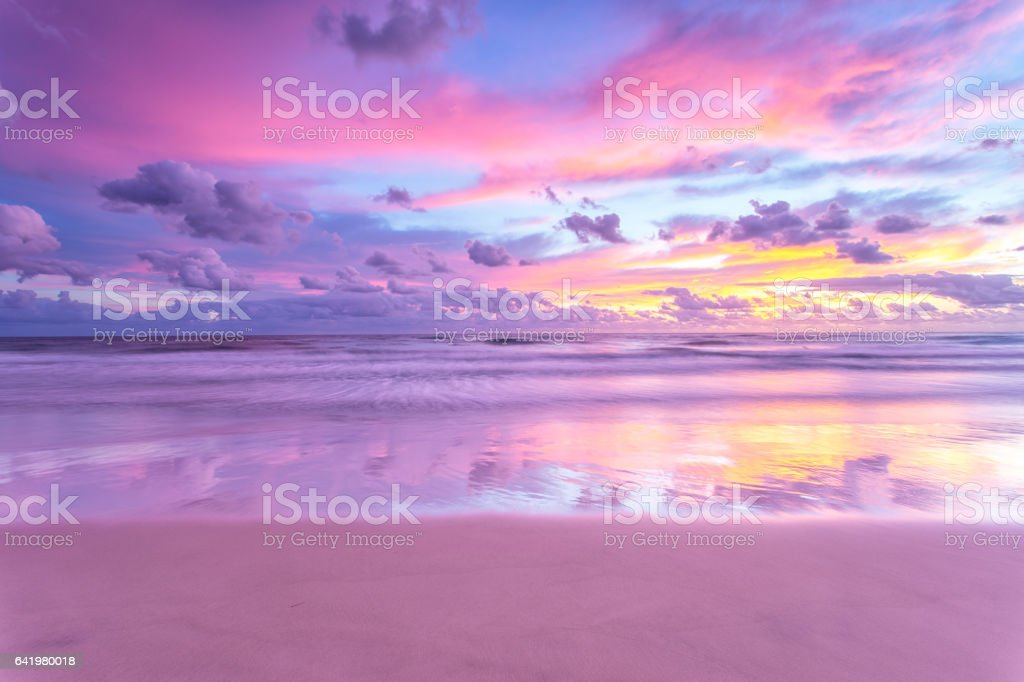 Sunrise reflections over the beach stock photo